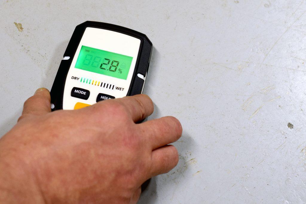 waterproofing specialist using moisture device