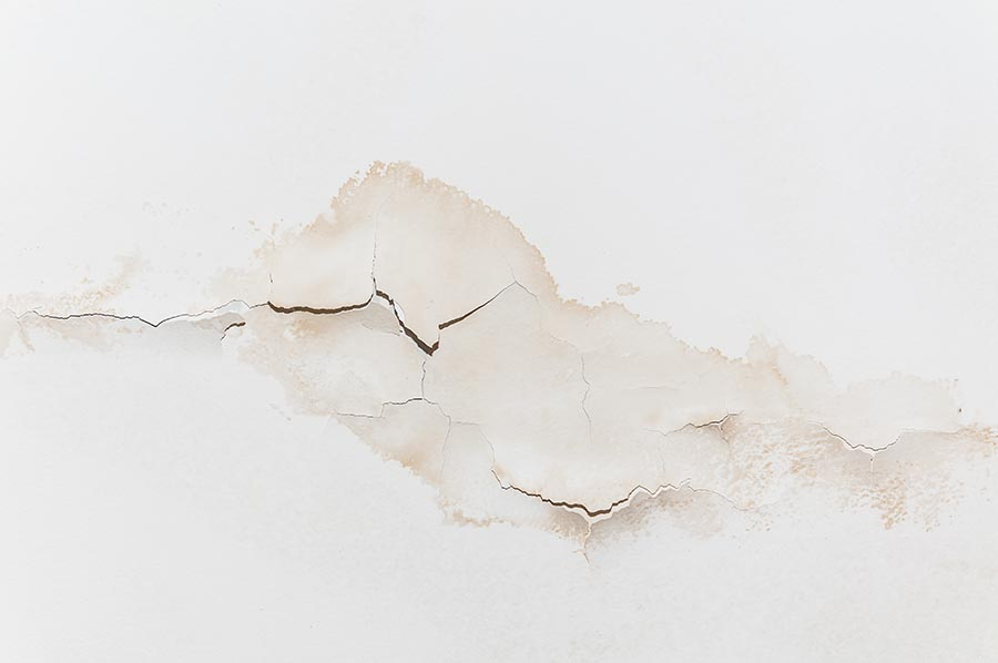 water stains appearing on white ceiling