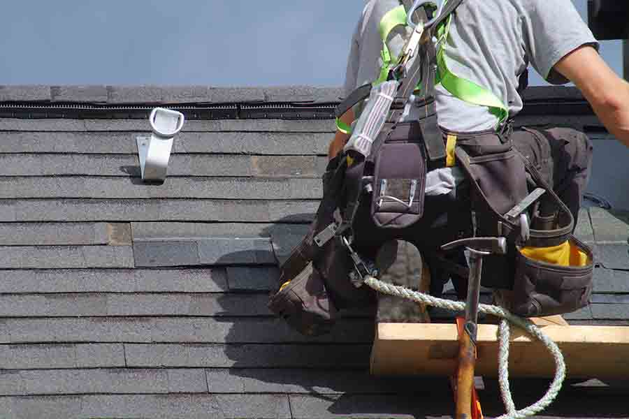 waterproofing contractor inspecting roof for leakages