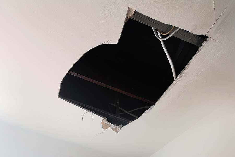 broken ceiling from water leakage damages